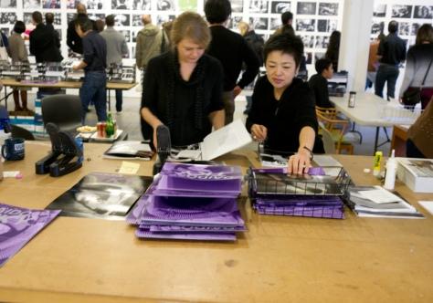 Stapling individual publications, Printing Show, Daido Moriyama, New York (2011)